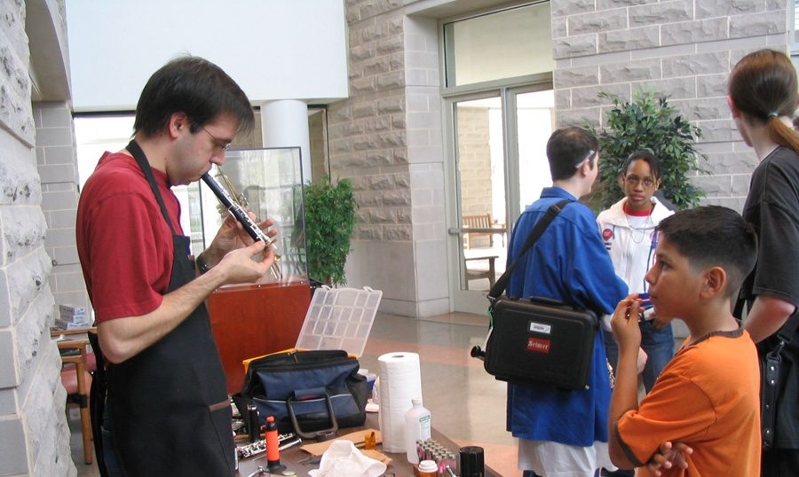 man repairing instrument