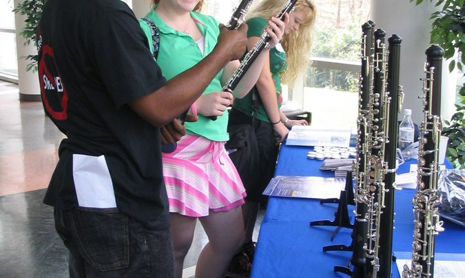 students admiring instruments