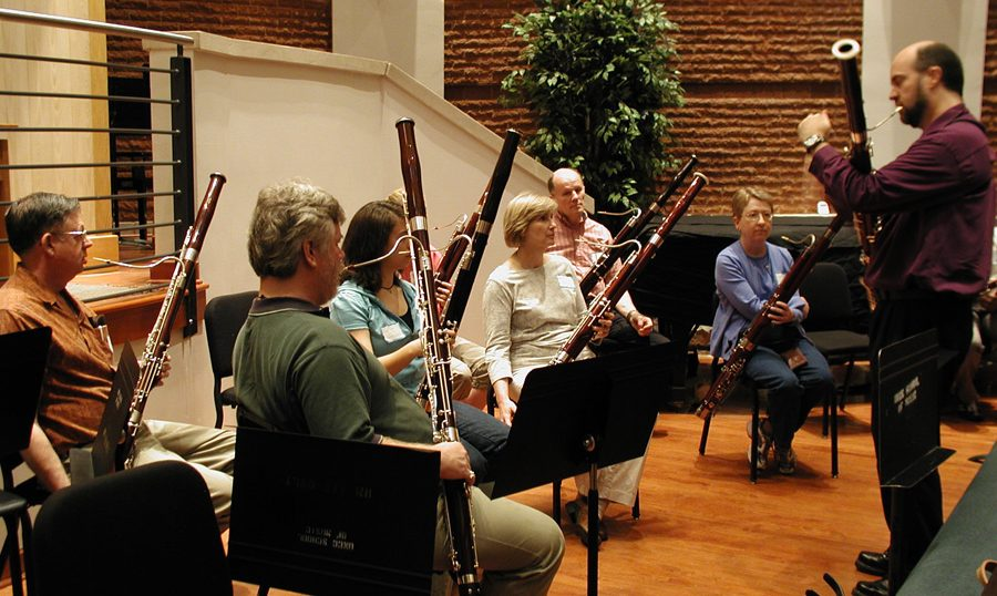 faculty seated with instruments