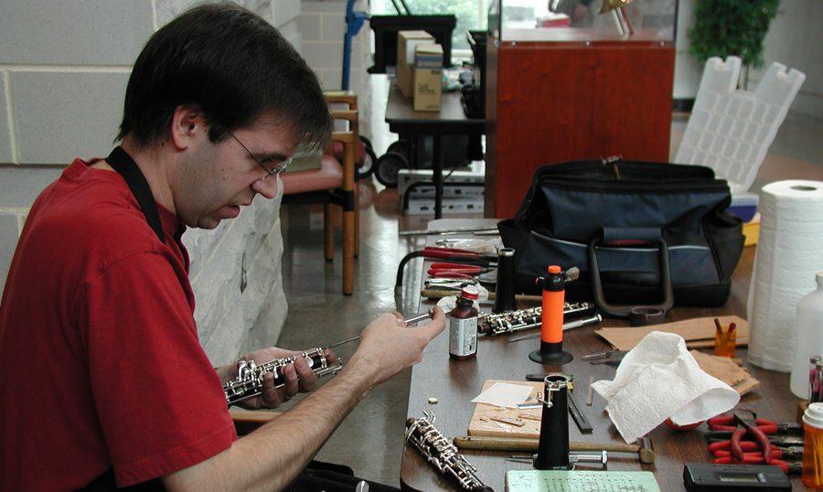 man repairing instruments