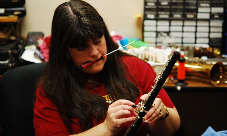 woman fixing instrument