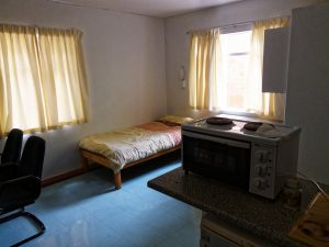 bed with microwave and window