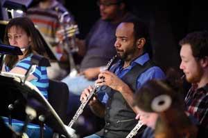 man playing oboe