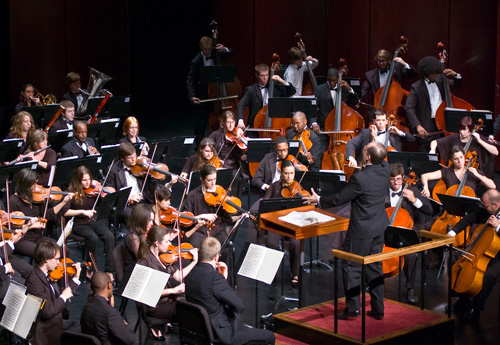 orchestra playing with conductor