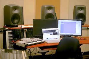 electronic music studio with computer and equipment