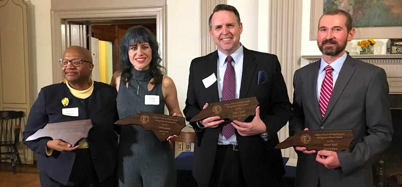 Alumni Award recipients holding awards