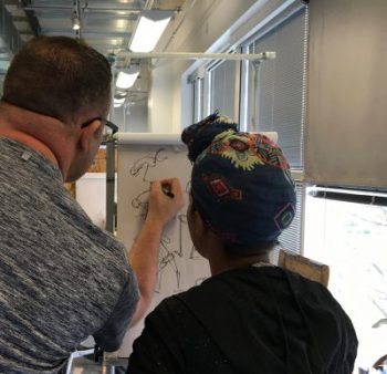 Visiting Artist working with student