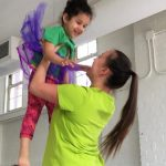 Dancing teacher with student
