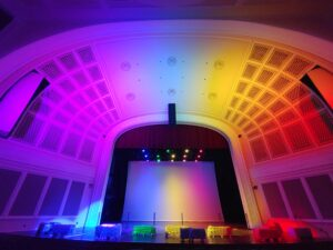 UNCG Auditorium bathed in a rainbow of light provided by new LEDs