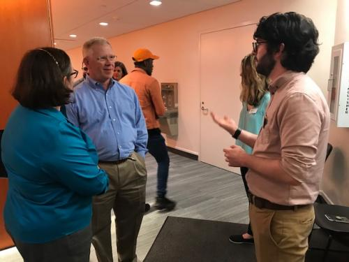 Tucker Daniel speaking with prospective parents at the 2018 Moveable Dance Feast celebrating the grand re-opening of their exciting space.