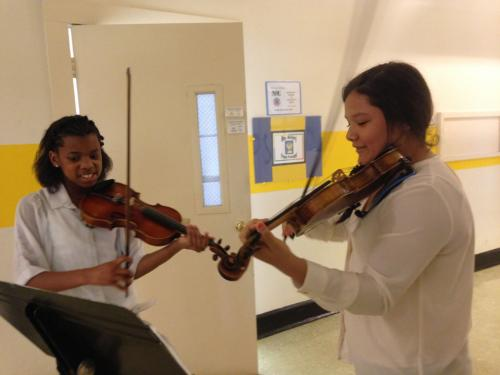 2 students playing violin