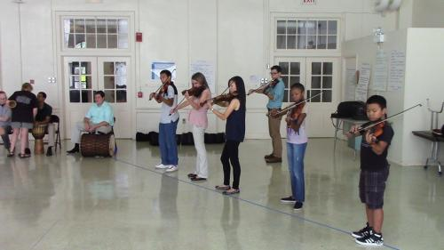 students standing to play violin