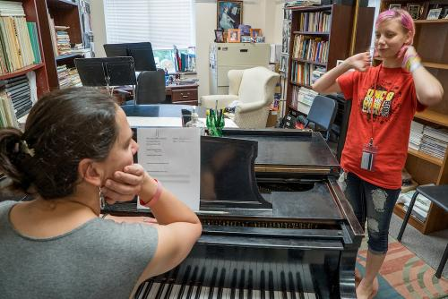 Student Alex Briles being instructed by Sarah Taylor at UNCG Summer Music Camp