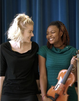 student and teacher with violin